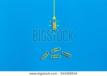 Great Ideas Concept With Paperclip,thinking,creativity,light Bulb On Blue Background,new Ideas Conce