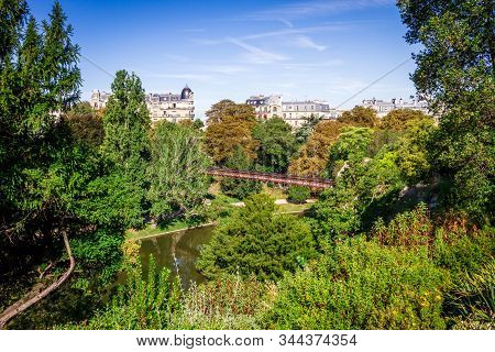 Pond And Bridge In Buttes-chaumont Park In Summer, Paris
