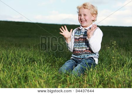 Little Boy Clapping His Hands In Glee