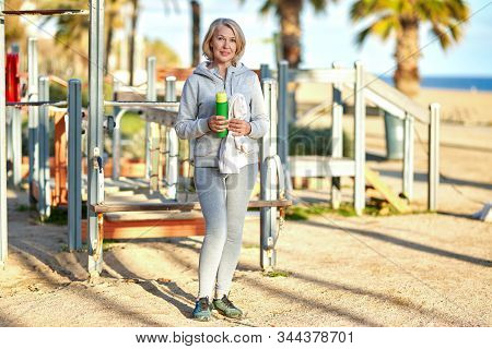 Adult Woman After Sports By The Sea.
