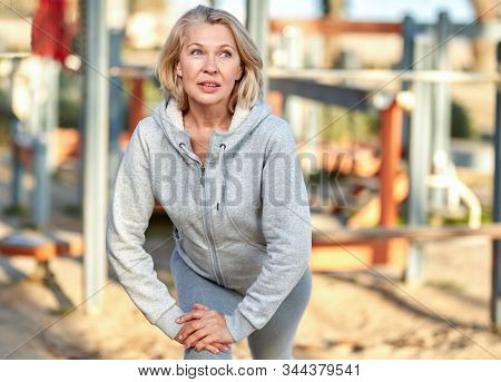 Elderly Attractive Woman During Sports By The Sea.