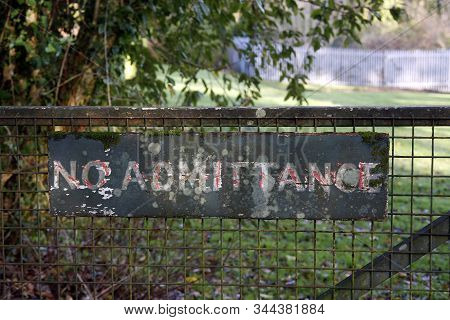 Old No Admittance Sign On A Metal Gate