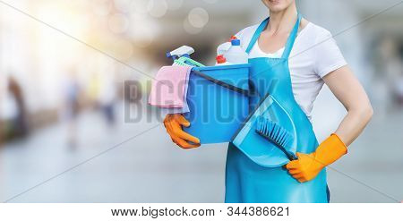 Concept Cleaning Services And Housework. The Cleaning Lady With A Dustpan And Brush For Cleaning.