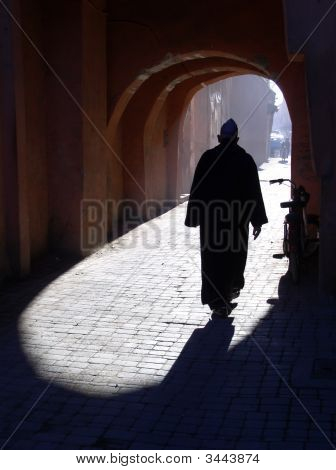 Silhouette Of Arab Person Walking On Street