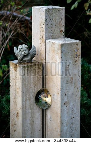 Modern Tombstone With An Inserted Glas Ball And Little Angel