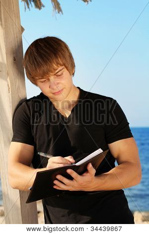 Young Business Man Waiting For Meeting, Working With Papers, Outdoors