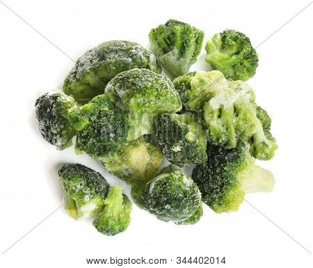Pile Of Frozen Broccoli Florets Isolated On White, Top View. Vegetable Preservation