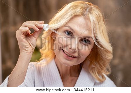 Mature Lady Taking Care Of Her Skin