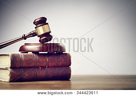 Judge gavel and law books in court, law and justice background concept with copy space
