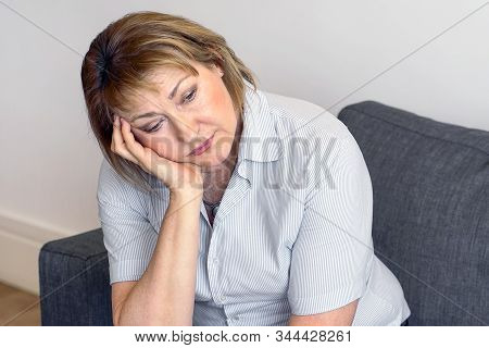 Sad Senior Woman. Mature Woman Sad Middle Aged Worried Concerned About Problems, Serious Depressed S