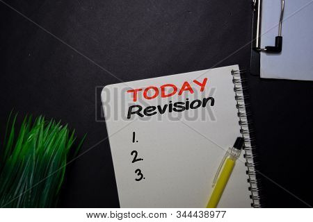 Today Revision Write On A Book Isolated On Black Table.