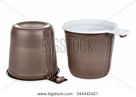 Standing And Upside Down Two Unused Disposable White Plastic Mugs With Brown Satin Texture On The Ou