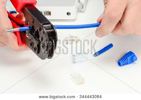 Engineer Cutting Patch Cord With Crimping Tool For Internet Wi-fi Router, Rj45 Connectors, Blue Boot