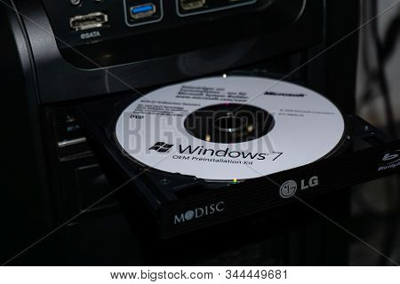 Wildflecken, Bavaria, Germany - January 11, 2020 An Original Microsoft Windows 7 Dvd In A Dvd Drive