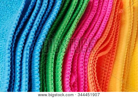 Pile Of Multicolored Cloths Used For Background Wallpaper Textures