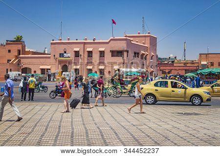 Marrakesh, Morocco - Jun 07, 2019: View Of People Walking On Jemaa El Fnaa Main City Square. It Is A