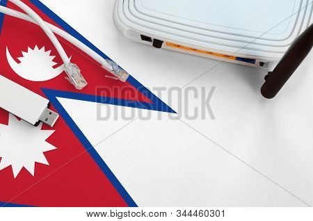 Nepal Flag Depicted On Table With Internet Rj45 Cable, Wireless Usb Wifi Adapter And Router. Interne