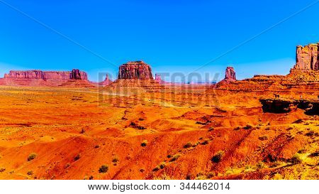Horse At John Ford Point With Towering Red Sandstone Formations Of Sentinel Mesa, Merrick Butte And