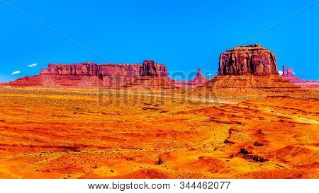 The Towering Red Sandstone Formations Of West Mitten Butte, Sentinel Mesa, Merrick Butte In Monument