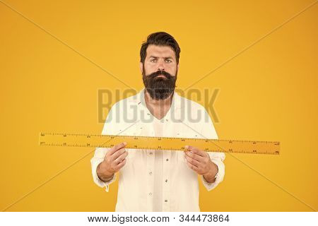 Does Size Really Matter. Man Bearded Hipster Holding Ruler. Measure Length. Size Tall And Length. Bi