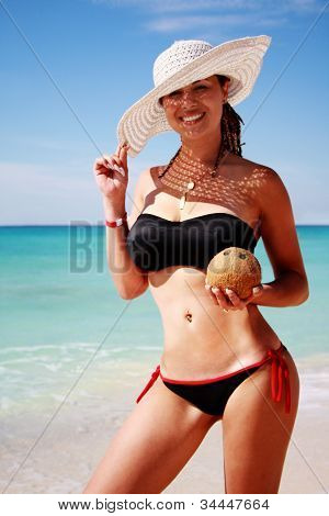 Girl With Hat In Paradise By The Sea