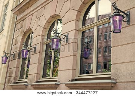 Wanderlust And City Dust. Old Building Architecture. House Facade With Windows And Lanterns. Archite