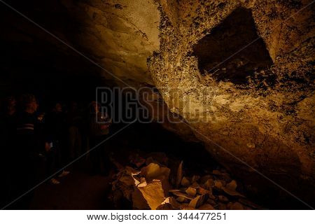 Mammoth Cave, United States: May 6, 2019: Park Visitors Inspect Rock Formation In Mammoth Cave