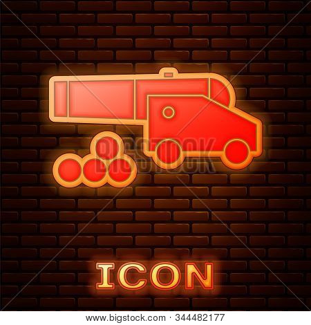 Glowing Neon Cannon With Cannonballs Icon Isolated On Brick Wall Background. Medieval Weapons. Vecto