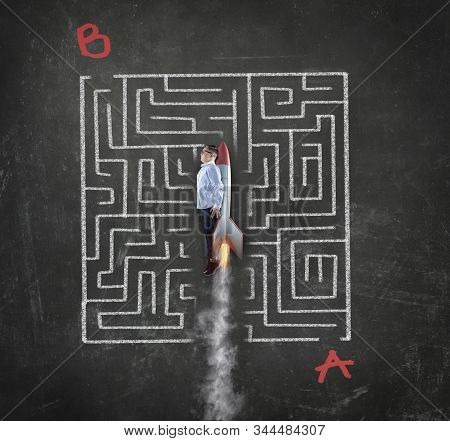 Young Businessman Flying With A Rocket Through A Maze . Solving The Maze Shortcut Concept. Point A T