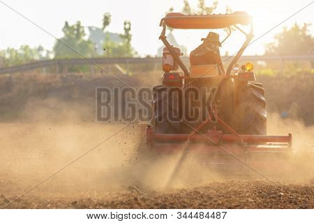 Thai Farmer On Big Tractor In The Land To Prepare The Soil