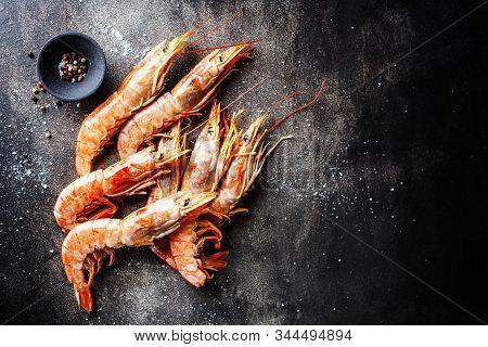 Raw Giant Shrimps On Dark Table