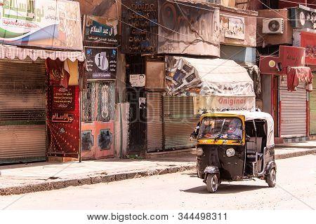 Edfu Egypt19.05.2018 The Tuk-tuk Taxi, A Popular Transportation Vehicle In Egypt Driving Through Str