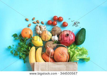 Healthy Food Background. Healthy Vegan Vegetarian Food In Paper Bag Vegetables And Fruits On Blue, C