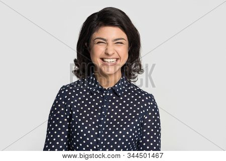 Head Shot Portrait Young Indian Ethnicity Overjoyed Woman Laughing.