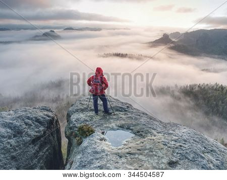 Extreme Trail Walker Stop For Relax Above Canyon Full Of Heavy Mist.  The Full Lengh Body Mirroring