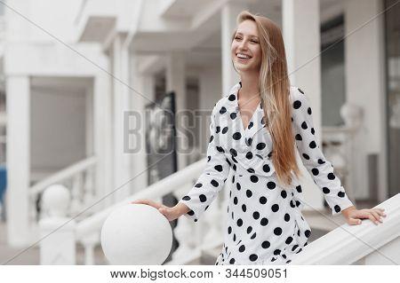 Young Beautiful Blonde Caucasian Woman Walking Summer Streets. Beautiful Girl, Urban Portrait.young