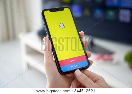 Anapa, Russia - October 4, 2019: Woman Hand Holding Iphone 11 With Social Networking Service Snapcha