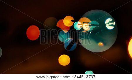 Colorful Octagons Blink On Dark Background. Multicolored Defocused Lights Blinking.