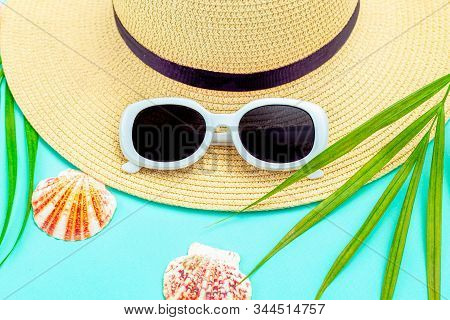 Travel.  Ыtraw Hat And  White  Sunglasses On Mint Background. Tropical