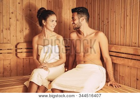 Happy Couple Relaxing Inside Sauna Spa Resort Hotel - Romantic Young Lovers Having Relaxing Day In L