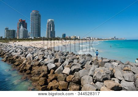 Miami,usa-march 15,2018:people On Hte Beach In Miami Beach South Point Park Pier During A Sunny Day.