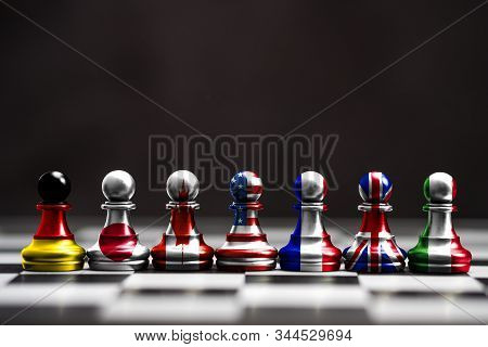 Flag Of G7 Countries Print Screen On Pawn Chess With Black Background. G7 Are Includes Usa Germany J