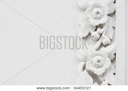 White flower stucco bas-relief