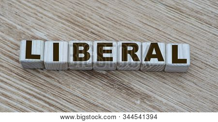 Concept Of The Word Liberal On Cubes On A Wooden Background