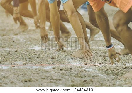 Students Fitness Training For Sprinting On An Athletic Track In School.