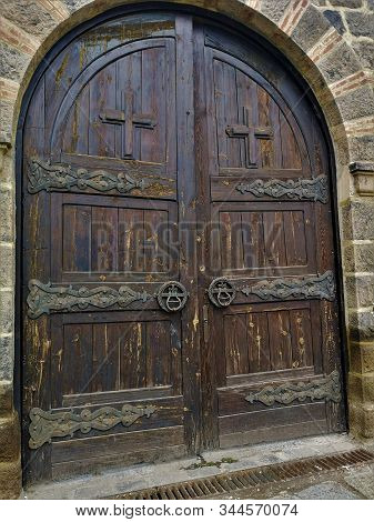 A View Of An Arch Shaped Wooden Door In The Perimeter Wall Of The Gracanica Monastery Near Prishtina