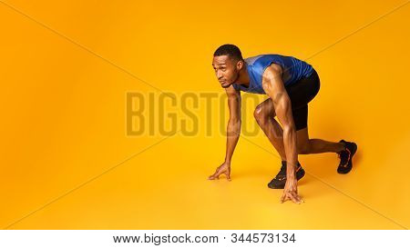 Time To Start. Muscular Black Sportsman Preparing For A Run, Looking Up At Copyspace, Panorama, Yell