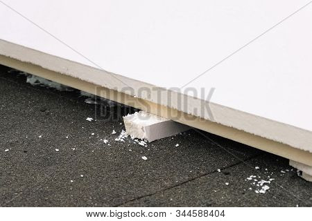 Roofing Insulation, Installation Of Insulation Sheets On Foam. Foam And Insulation.
