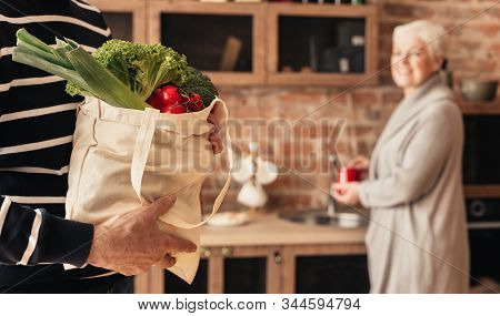 Eco Friendly Shopping. Senior Couple Unpacking Fabric Bag With Organic Food, Panorama
