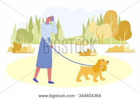 Active Senior Woman Walking With Dog In City Park At Summer Time. Granny Relaxing With Pet On Nature